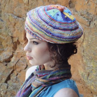A ColourSpun Pure Cotton beret. worked from the centre of the crown out in wedges and circular stripes.. it is knit but has the option of adding crochet for extra texture