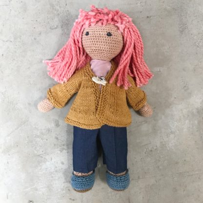 Crochet doll wearing flared Cardigan and long pants